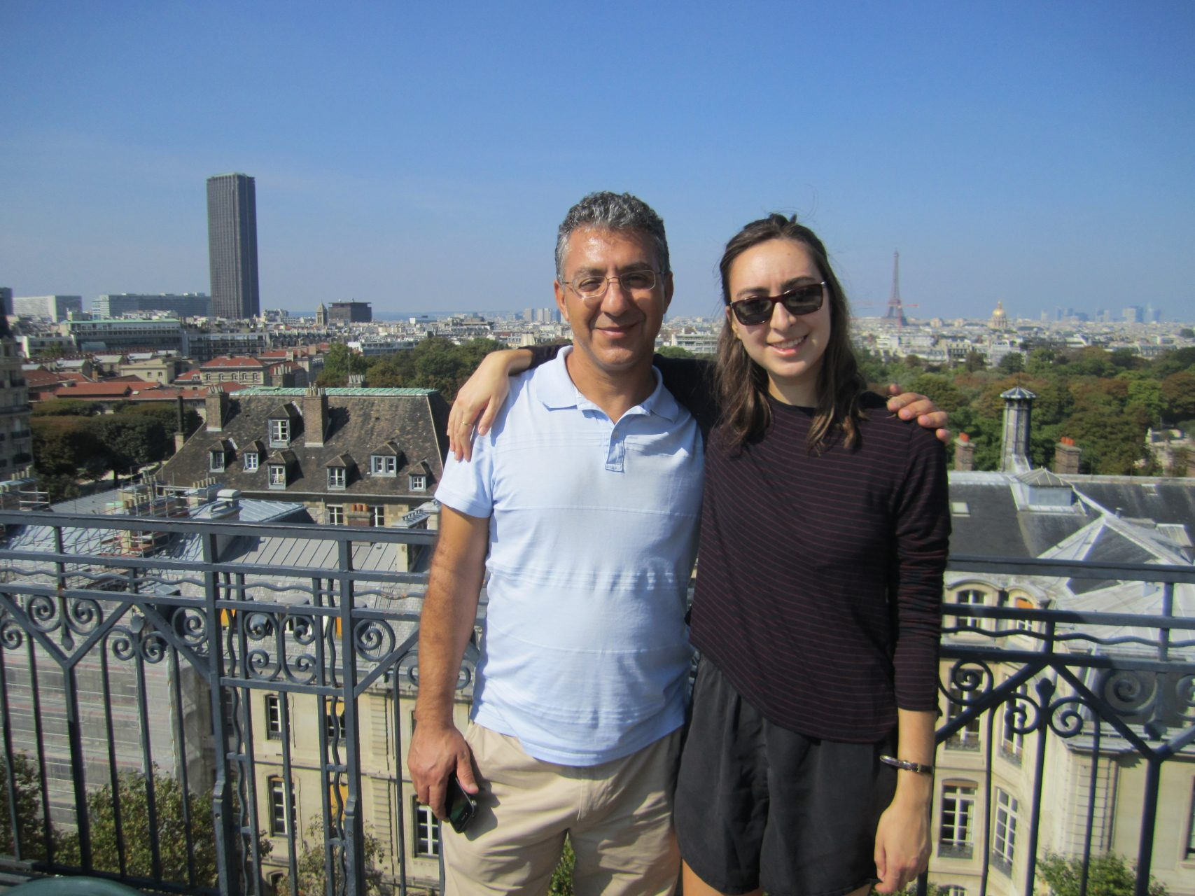 My dad and I on the roof of my dorm in Paris, overlooking the city.